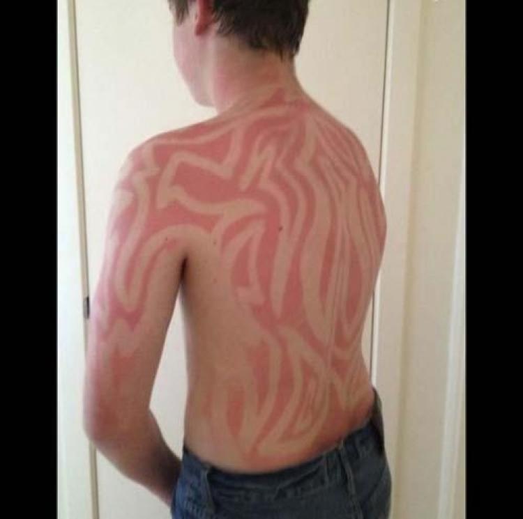 Abbronzatura Tribal Tattoo